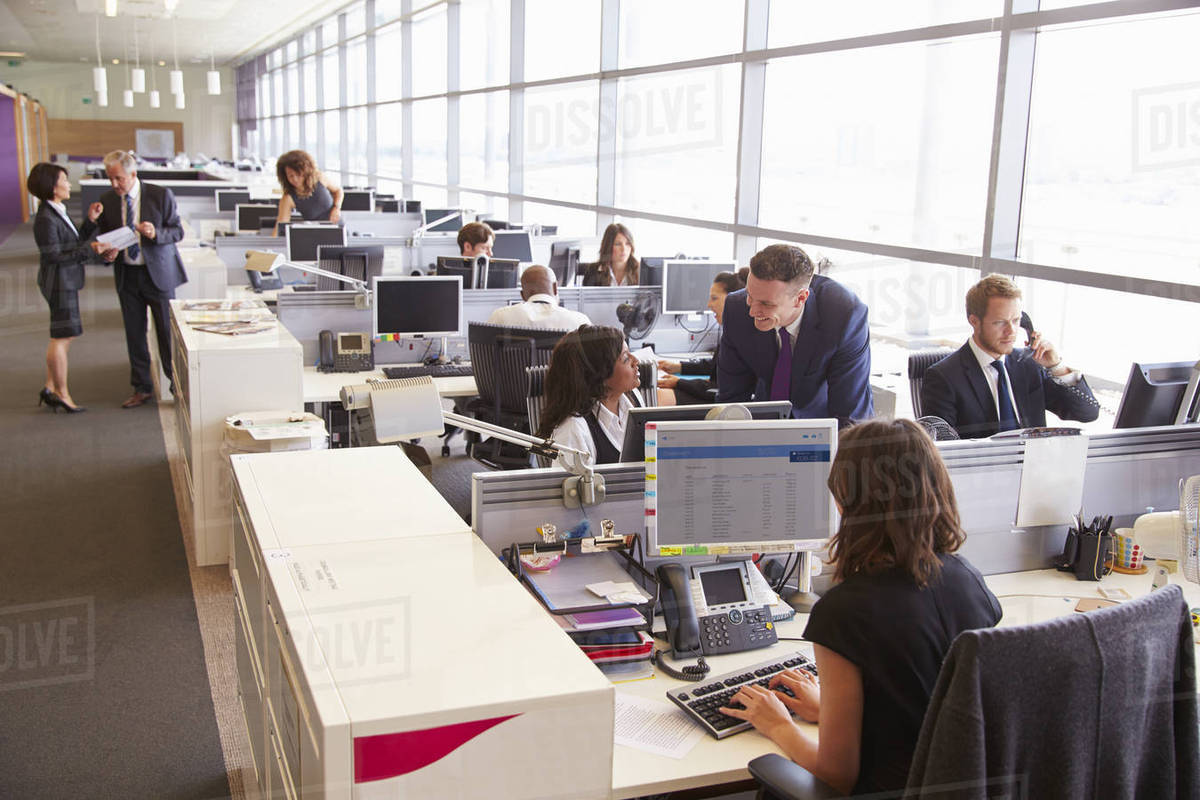 Manager in discussion with coworker in an open plan office Royalty-free stock photo