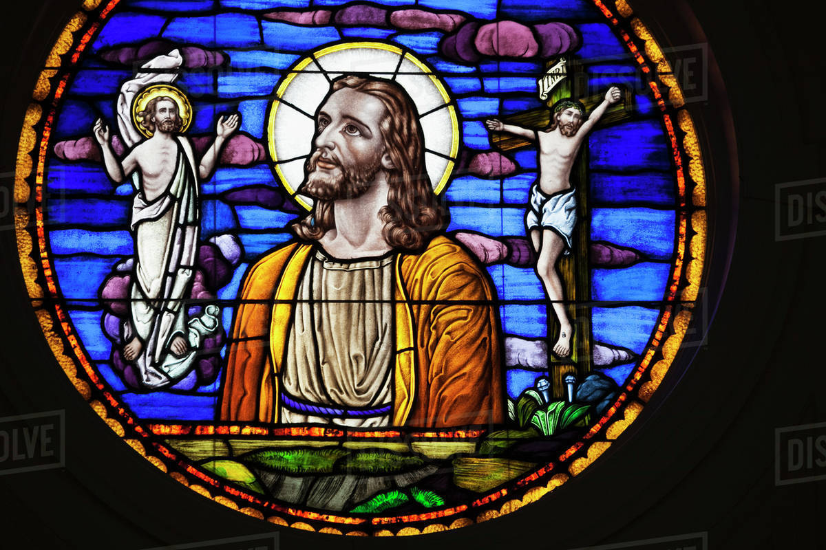 stained glass window depicting jesus christ and his death