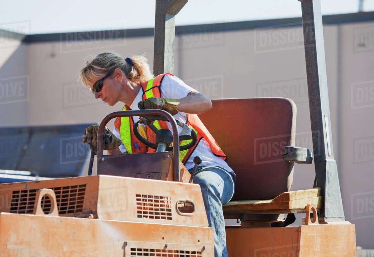 Driving gloves edmonton - Woman Driving Stream Roller Repairing Pot Holes In Parking Lot Edmonton Alberta Canada