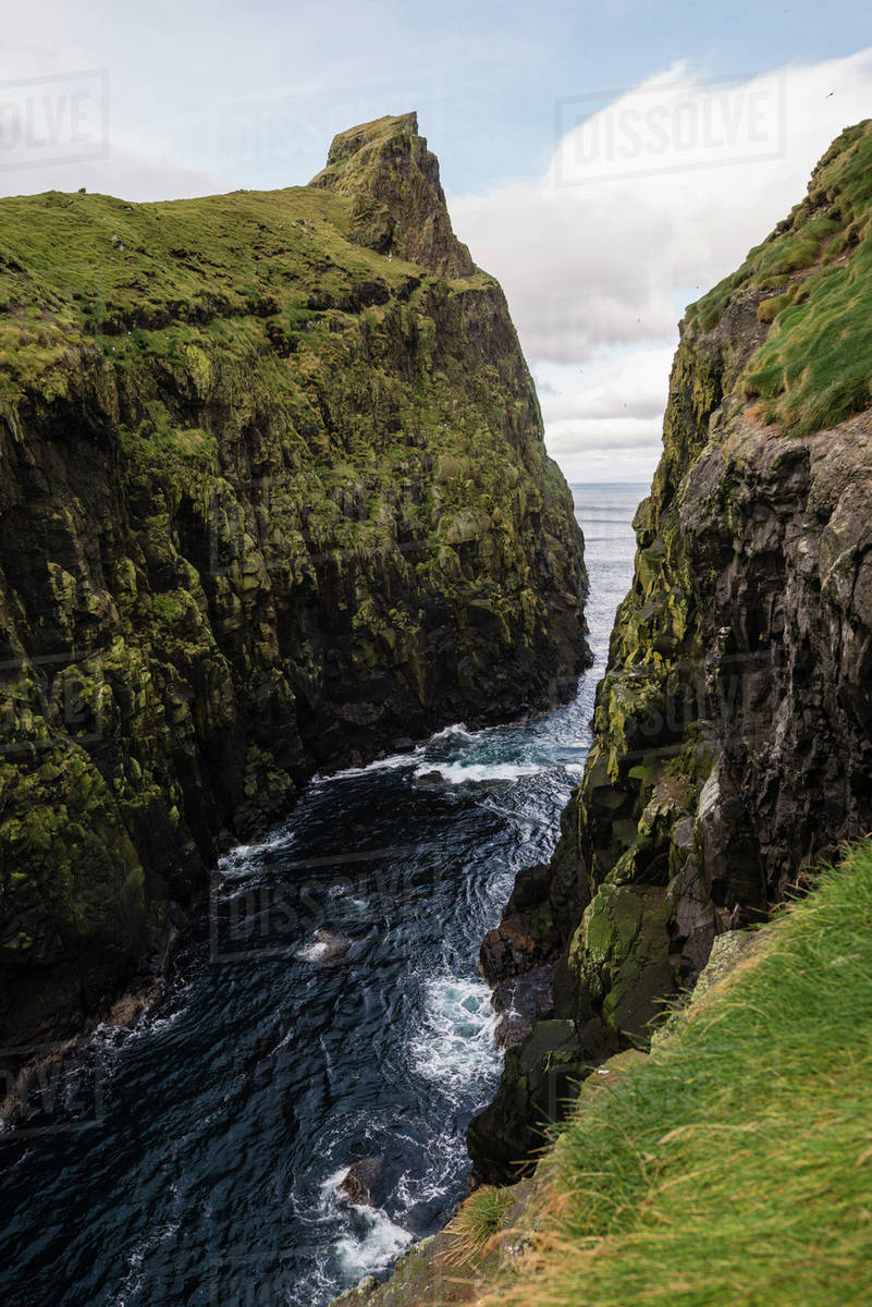 River flowing between huge cliffs at Faroe islands Royalty-free stock photo
