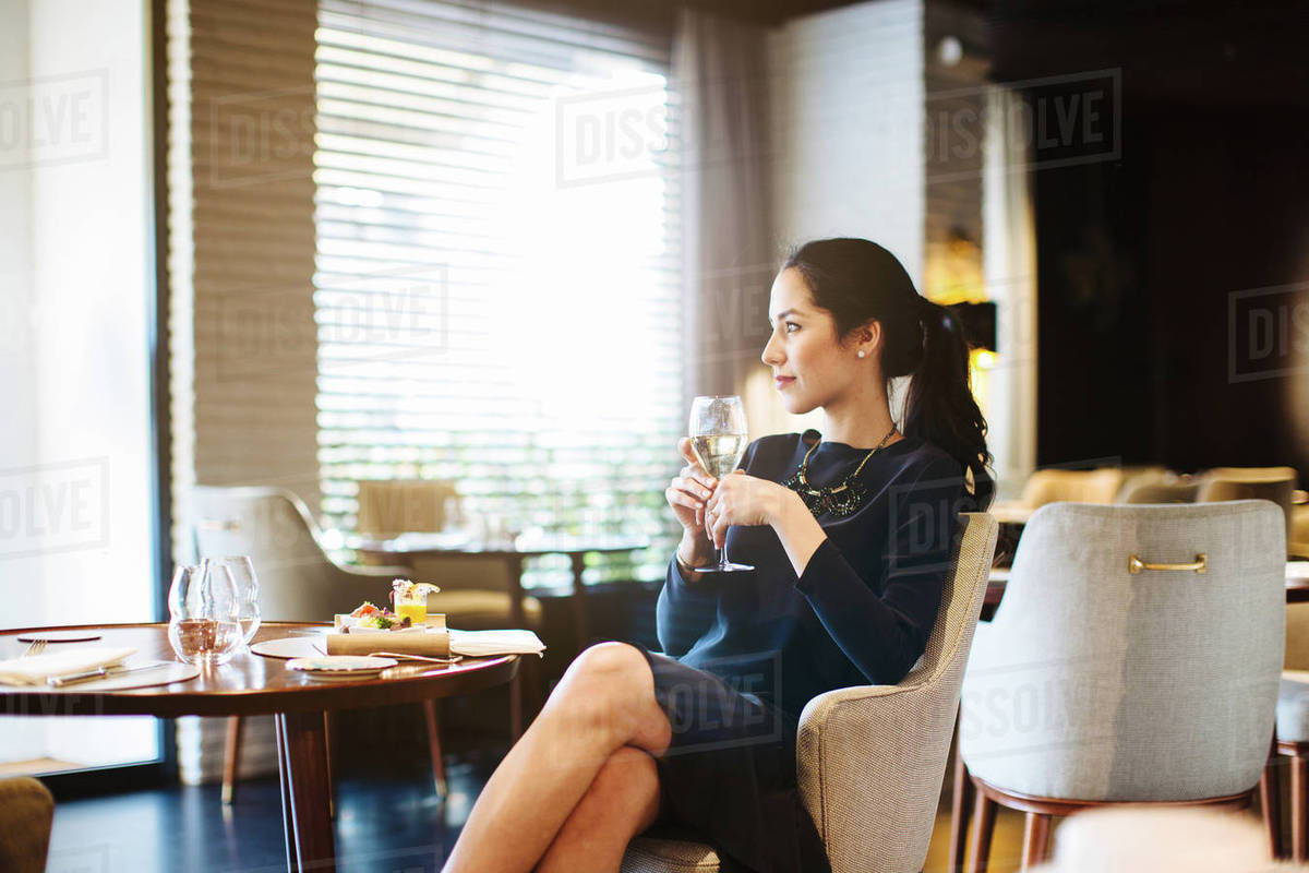 Young woman staying in boutique hotel enjoying aperitif Royalty-free stock photo