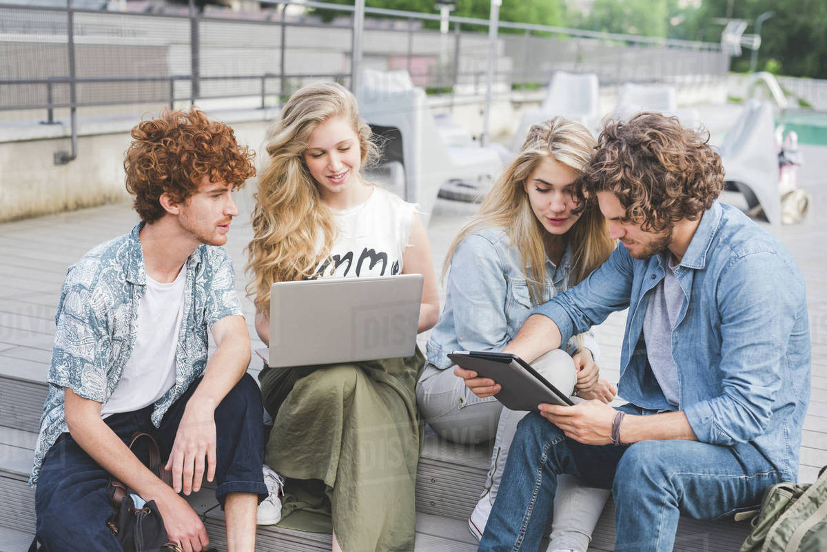 Friends on social media outdoors Royalty-free stock photo