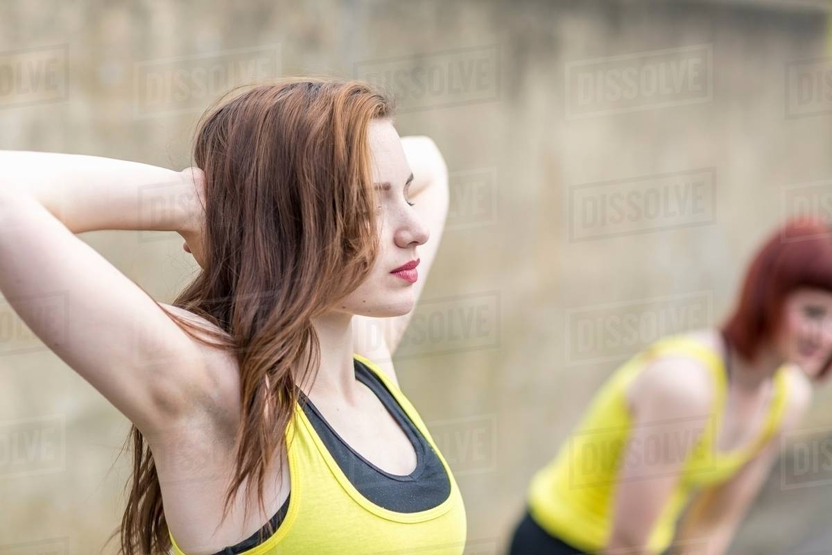 Young women stretching outdoors Royalty-free stock photo