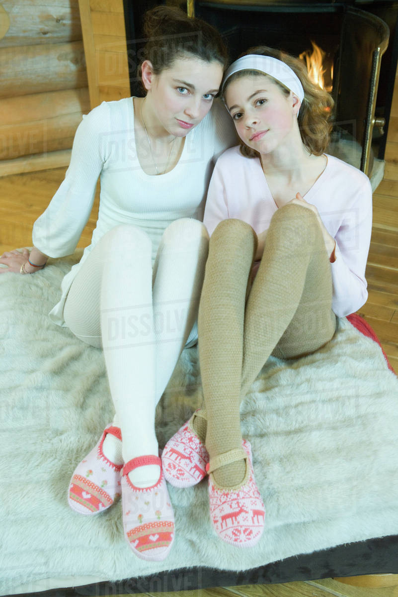 Two Teen Girls Sitting By Fireplace, Wearing Tights And Slippers, Looking At Camera -1098