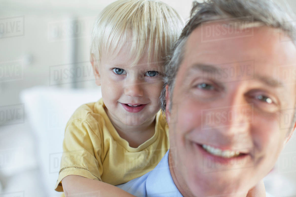Father carrying son piggyback Royalty-free stock photo