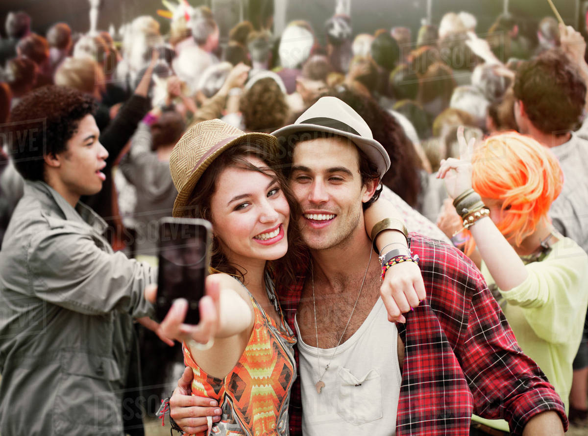Couple taking self-portrait at music festival Royalty-free stock photo