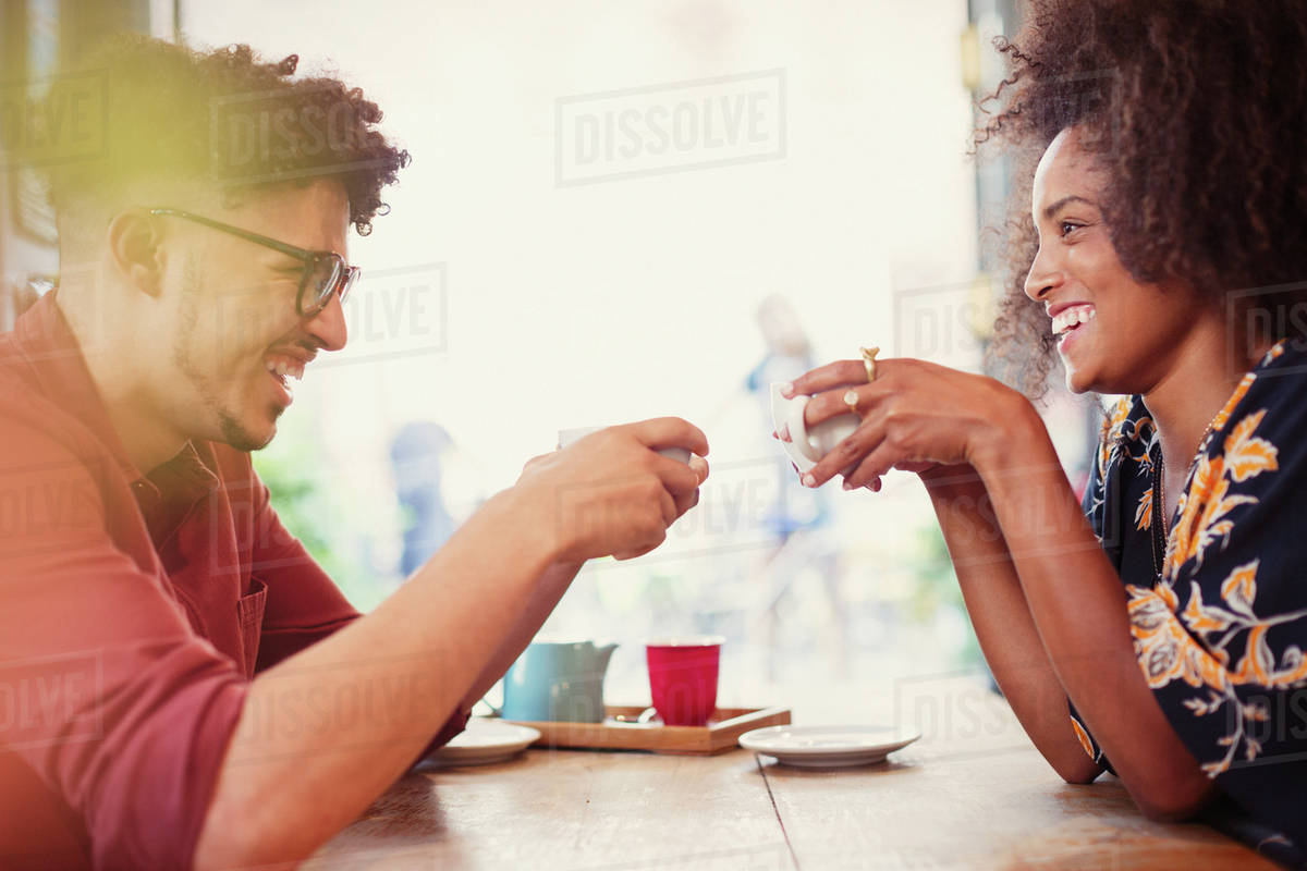 Couple drinking coffee face to face in cafe Royalty-free stock photo