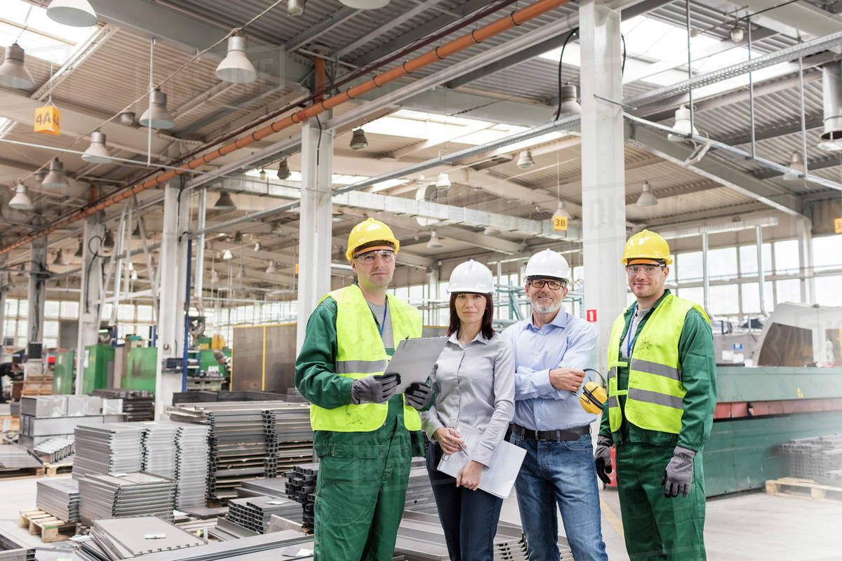 Portrait confident engineers and workers in steel factory Royalty-free stock photo