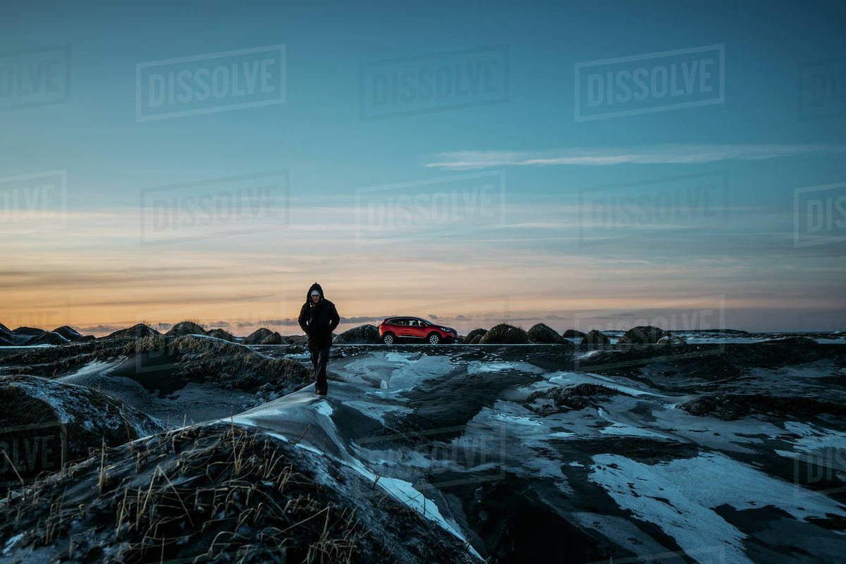 Man walking on icy mounds in remote landscape, Hofn, Iceland Royalty-free stock photo
