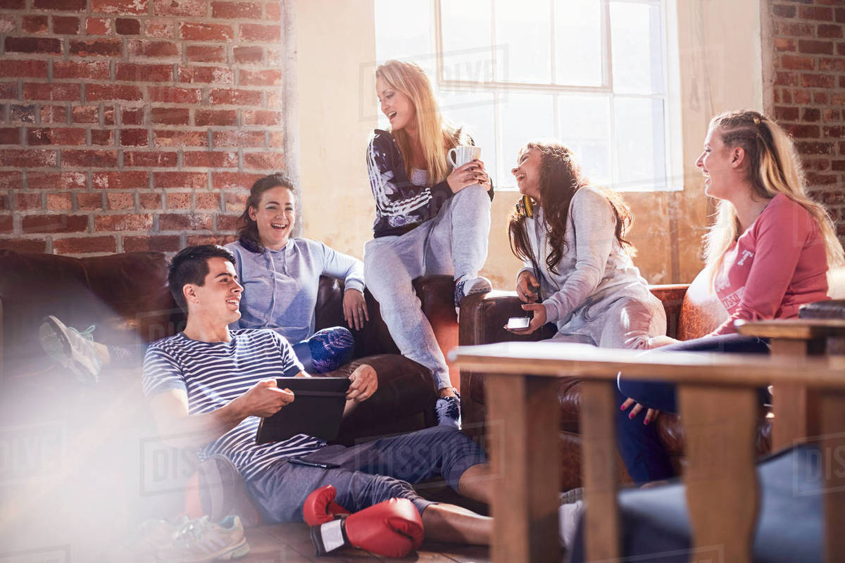 Young friends talking and hanging out in studio Royalty-free stock photo