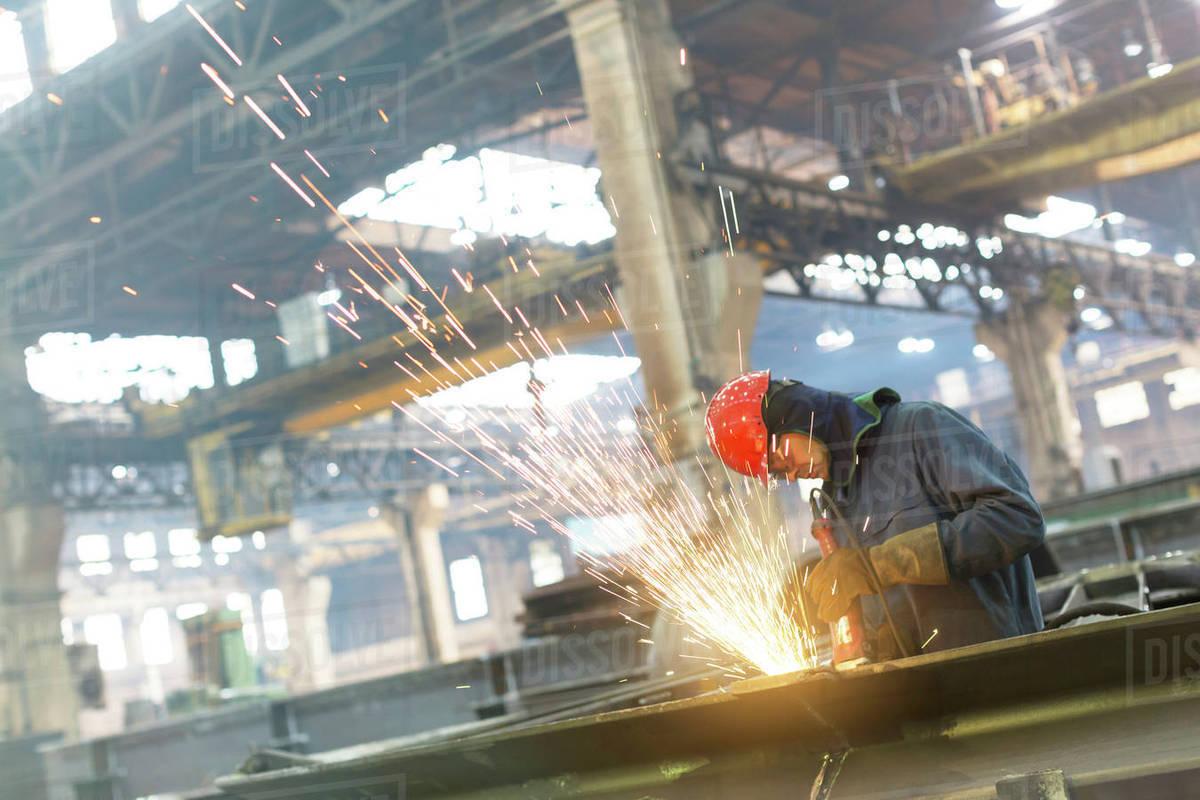 Welder using welding torch in steel factory Royalty-free stock photo