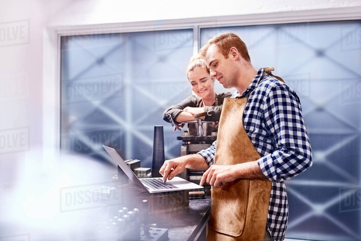 Jewelers using equipment and laptop in workshop Royalty-free stock photo