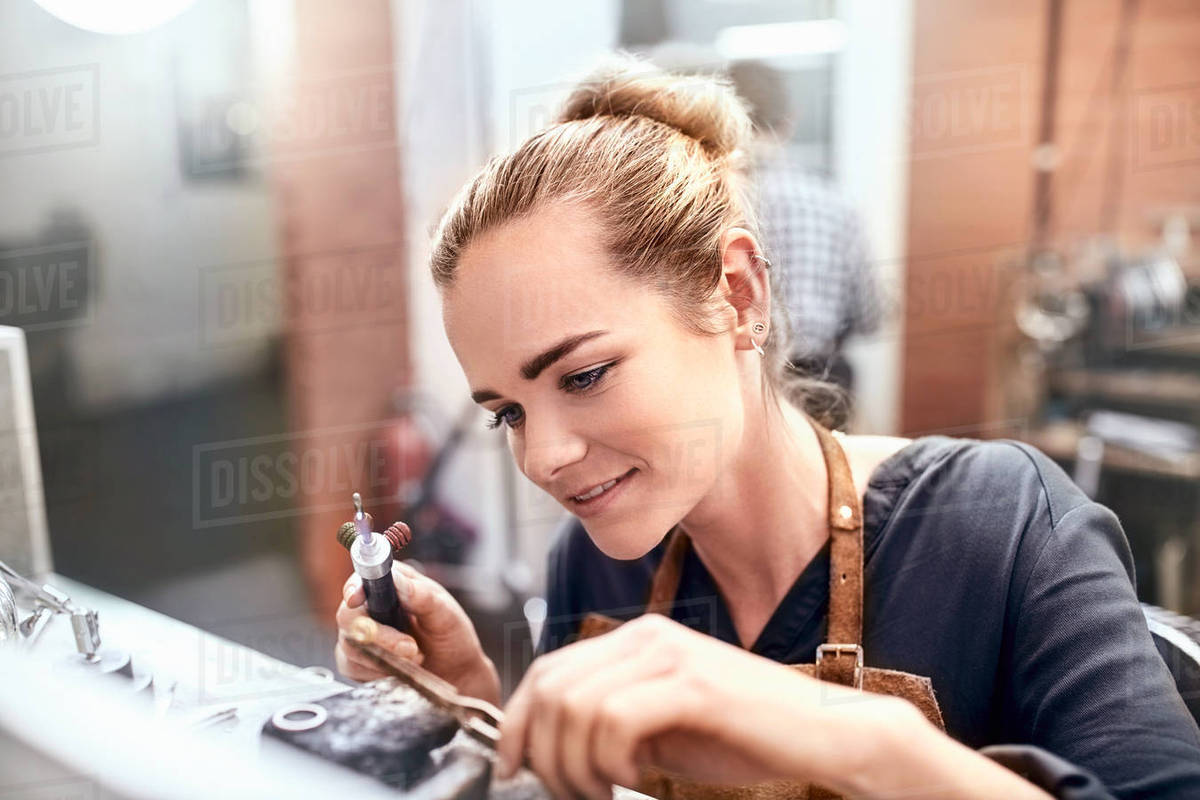 Female jeweler using equipment in workshop Royalty-free stock photo