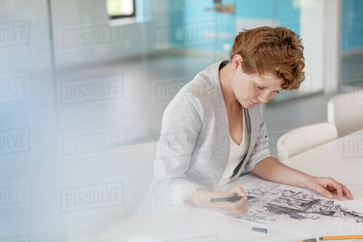 Female designer drawing sketch in office Royalty-free stock photo