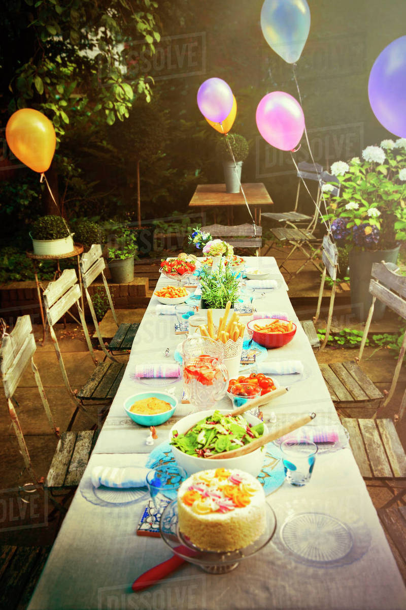 Balloons and food at garden party patio table Royalty-free stock photo