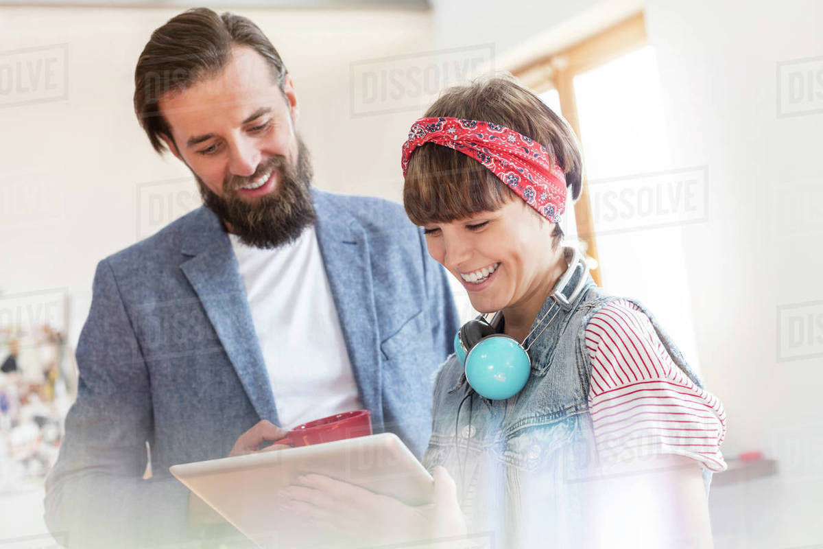 Smiling design professionals using digital tablet in office Royalty-free stock photo