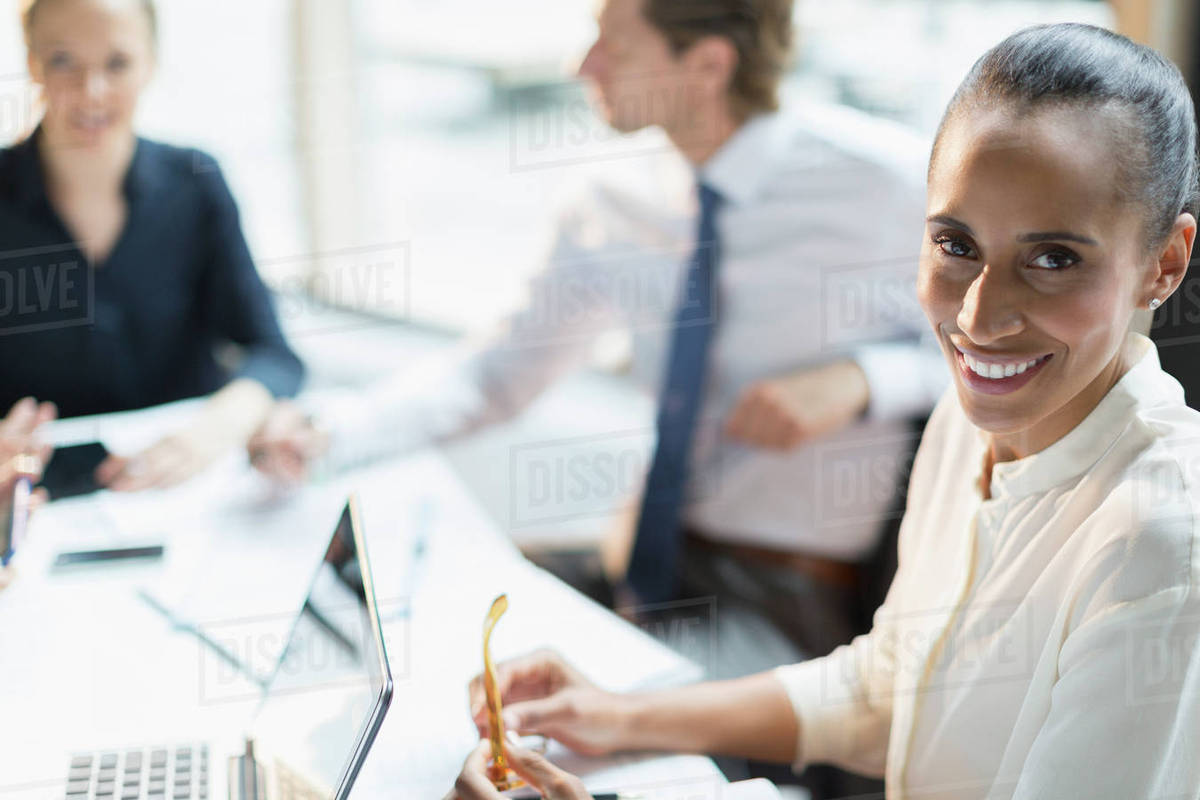 Portrait smiling businesswoman in conference room meeting Royalty-free stock photo