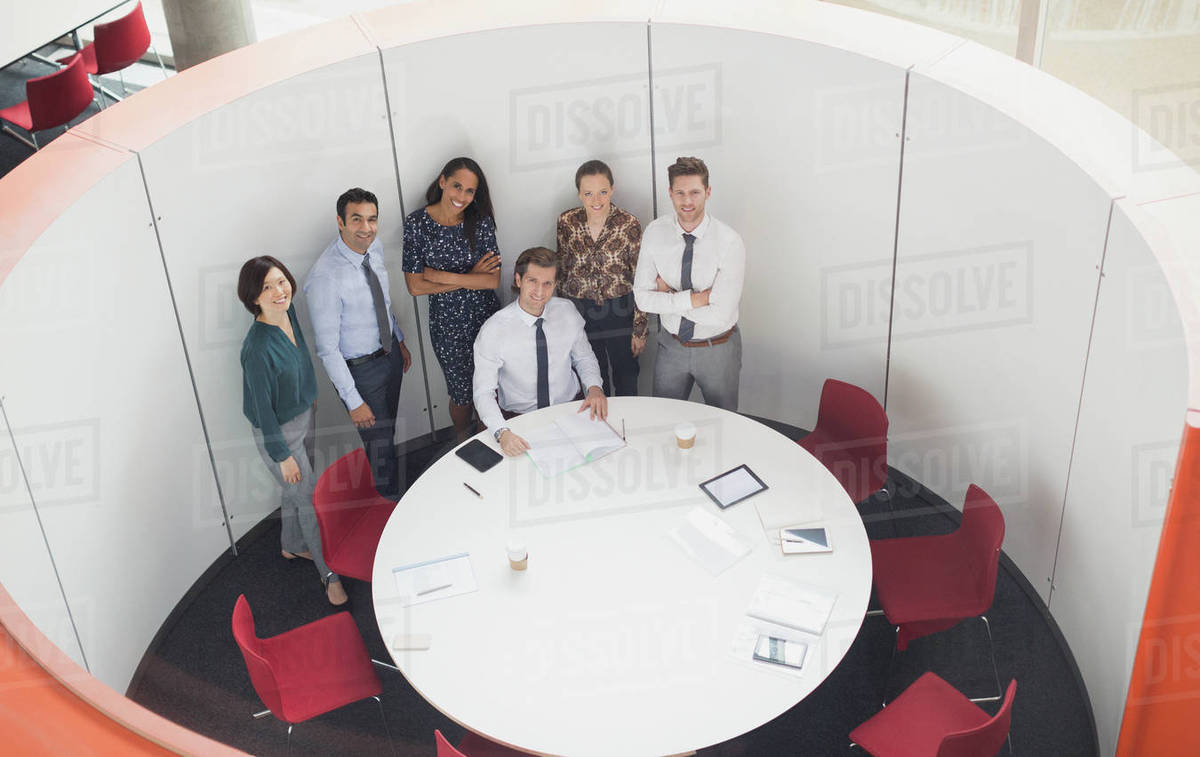 Portrait smiling business people meeting at round table conference room Royalty-free stock photo