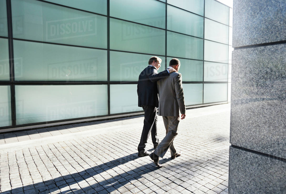 Businessmen talking on city street Royalty-free stock photo