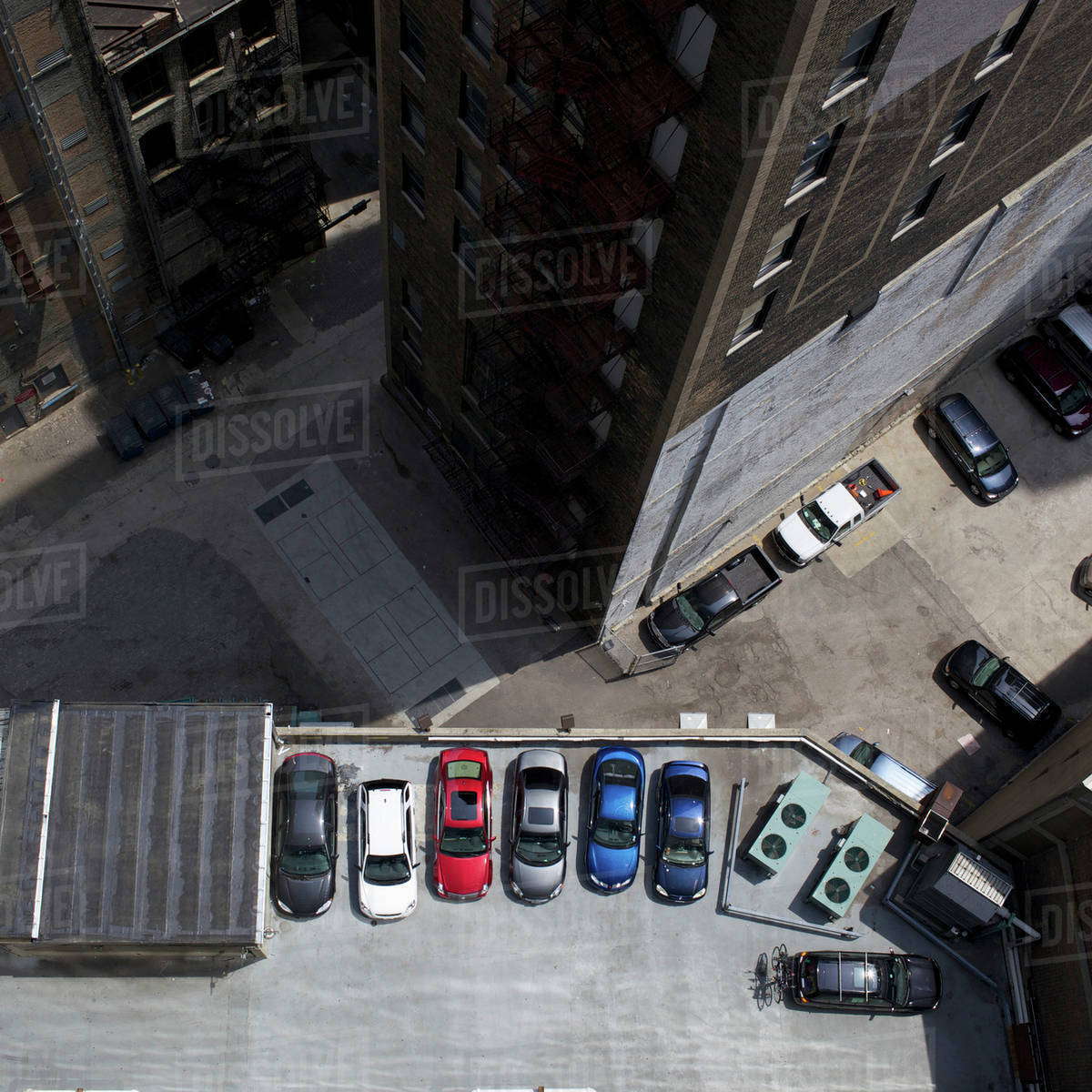 High angle view of city buildings and parked cars Royalty-free stock photo
