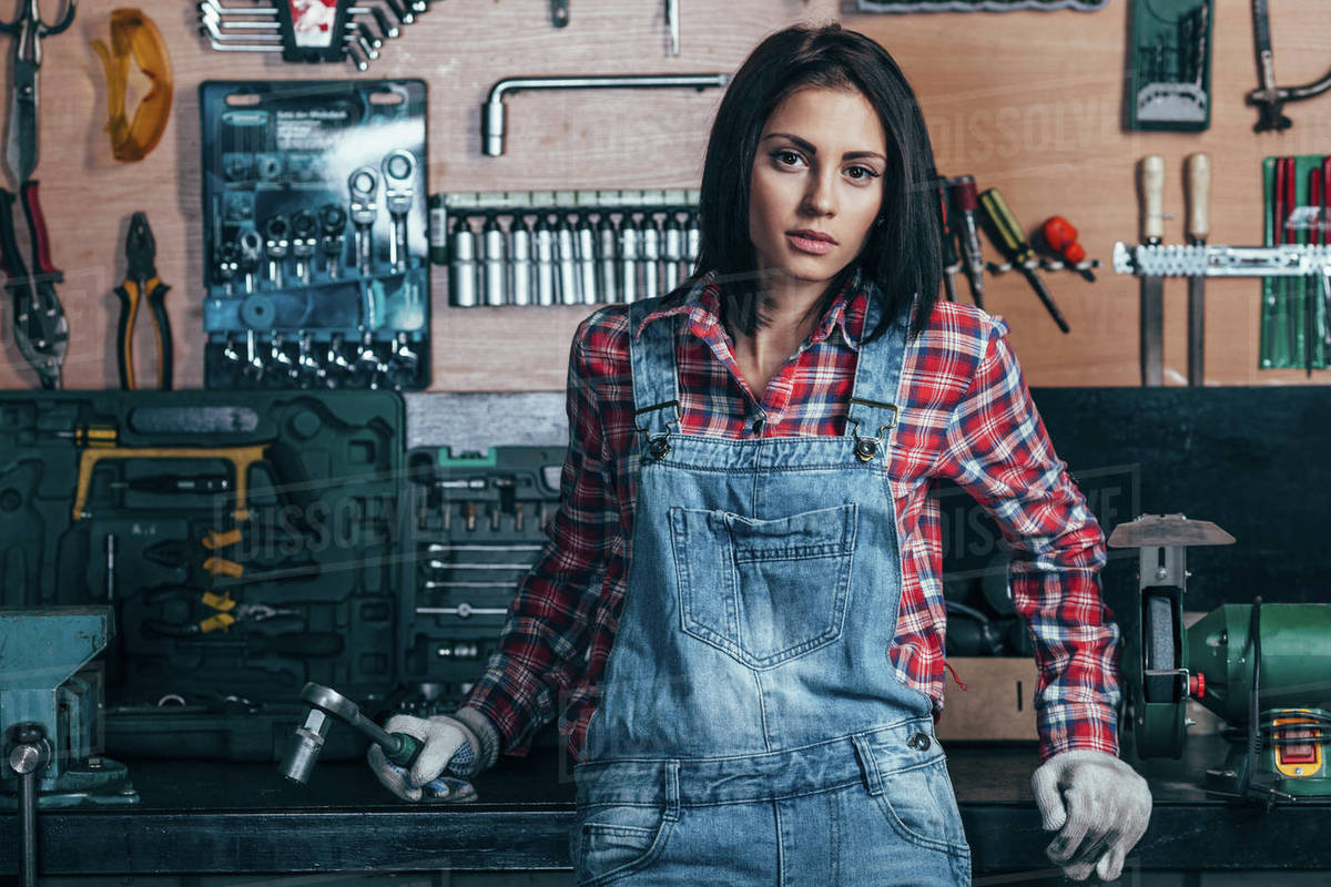 Portrait of female mechanic standing at workshop Royalty-free stock photo