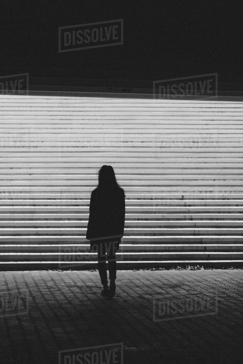 Silhouette woman standing by steps on sunny day Royalty-free stock photo